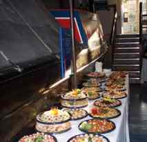 Buffet beside narrowboat on ground floor